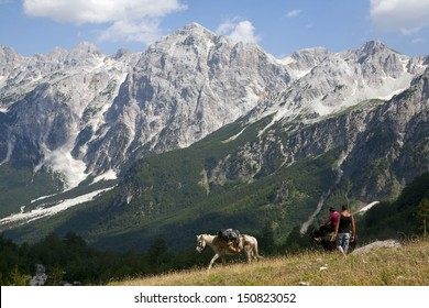 Hiking at Albanian Alps, horse for backpacks
