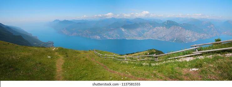 hiking area with breathtaking view to garda lake, monte baldo mass, italy