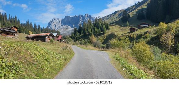 hiking area with wooden huts and view to mountain mass scheienfluh, region prattigau switzerland