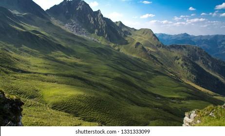 hiking in austria mountain meadow in summer