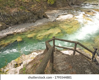 Hiking in Beautiful famous Suwakyo Gorge, footpath by the mountain river and bridge, snow capped Japanese Alps in background, Minakami