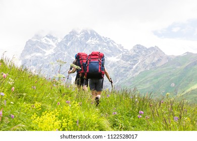 Hiking in beautiful mountains. Group of hikers enjoy sunny weather.