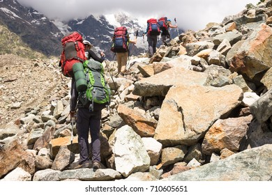 Hiking in beautiful mountains. Group of hikers enjoy sunny weather