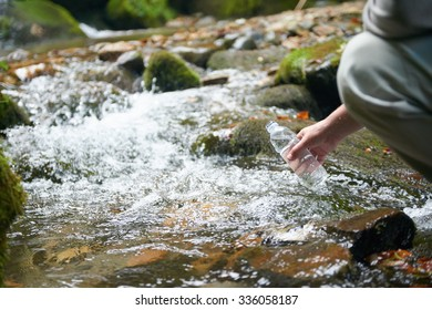 hiking in beautiful nature, man drink fresh water from spring