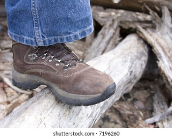 Hiking boot on log