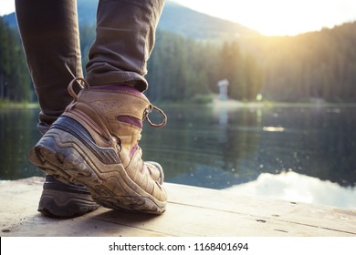 hiking boots close-up against the mountain lake synevyr. Carpathians,  Ukraine.