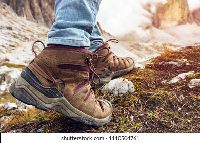 hiking boots close-up. tourist walking on the trail. Italy