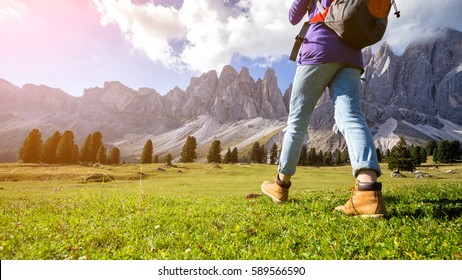hiking boots close-up. tourist walking at the Puez Odle. Italy