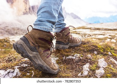 hiking boots close-up. tourist walking on the trail. Dolomites, Italy