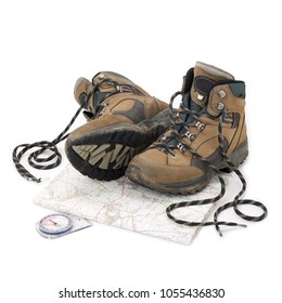 Hiking boots, walking map and compass isolated on white background