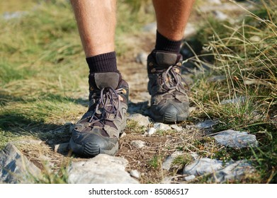 Hiking Boots/Hiking Boots and Legs of a Man on the Mountain Path
