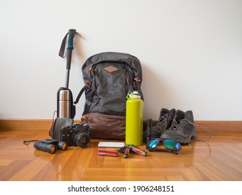 Hiking, camping and mountain tools on a wooden floor ready to go to the adventure