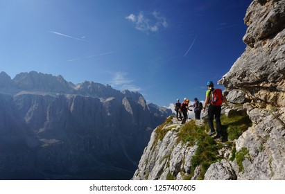 Hiking and climbing in Puez Odle - Piz da Cir in the Dolomites (Dolomiti mountains in Italy), on a sunny day of summer