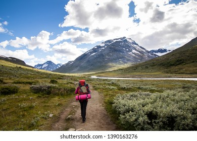 Hiking during sunny day in Jotunheimen National Park, Norway