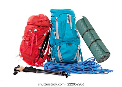Hiking equipment, rucksacks, poles, rope and slipping pad . Isolated on white background.