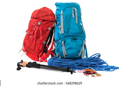 Hiking equipment, rucksacks, poles, rope. Isolated on white background.