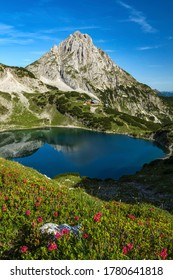 Hiking in european alps at lake drachensee near coburger hütte hut in ehrwald beautiful mountains and scenery