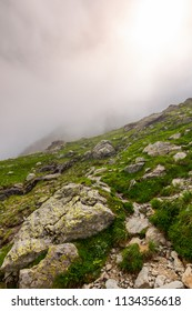 hiking in fog on a cloudy summer day. beautiful nature scenery on high altitude