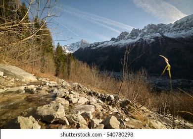 Hiking in the forests of the French Alps, Mont Blanc Massif, near Chamonix City, at the end of autumn, beginning of winter. France, Europe