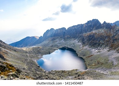 Hiking in High Tatras Mountains, Slovakia. Vysne Wahlenbergovo Pleso Lake (2154m) in Furkotska valley. Is the second highest situated lake in the Tatras. Mount Ostra (2351m) on the background