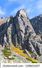 Hiking in High Tatras Mountains (Vysoke Tatry), Slovakia. Mlynicka Valley. On the way to Skok waterfall (1789m) (Slovak: Vodopad Skok). Mount Mala Basta (2288m)