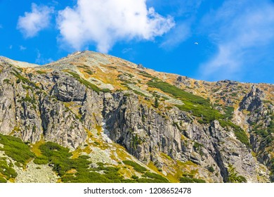 Hiking in High Tatras Mountains (Vysoke Tatry), Slovakia. Mlynicka Valley. On the way to Skok waterfall (1789m) (Slovak: Vodopad Skok). Sunny autumn day