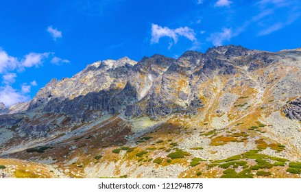 Hiking in High Tatras Mountains (Vysoke Tatry), Slovakia. On the way to Skok waterfall (1789m) (Slovak: Vodopad Skok). Mount Satan (2421m) on the background. Sunny autumn day
