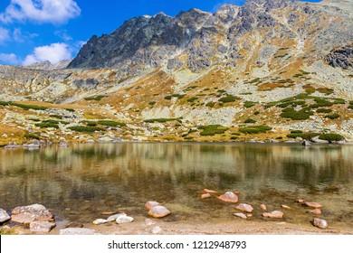 Hiking in High Tatras Mountains (Vysoke Tatry), Slovakia. Lake over Skok waterfall (Slovak: Pleso nad Skokom) (1801m). Mount Satan (2421m) on the background