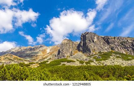 Hiking in High Tatras Mountains (Vysoke Tatry), Slovakia. On the way to Skok waterfall (1789m) (Slovak: Vodopad Skok). Mt.Mala Basta (2288m) and mt.Patria (2202) in the center