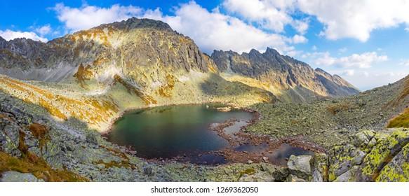 Hiking in High Tatras Mountains (Vysoke Tatry), Slovakia. Panoramic view of Lake over Skok waterfall (Slovak: Pleso nad Skokom) (1801m). Mount Satan (2421m) on the background