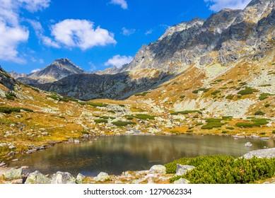 Hiking in High Tatras Mountains (Vysoke Tatry), Slovakia. Lake over Skok waterfall (Slovak: Pleso nad Skokom). Lies on 1801m directly above the Mlynicka dolina threshold above the Skok Waterfall