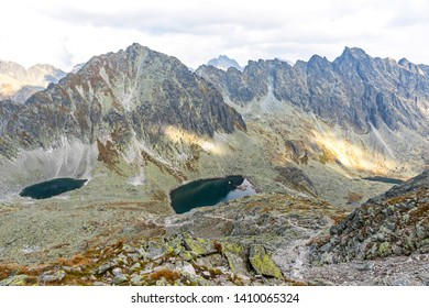 Hiking in High Tatras Mountains (Vysoke Tatry), Slovakia. Mlynicka Valley. Okruhle pleso lake (2105m) and Capie Pleso lake (2075m). Mount Strbsky Stit (2381m) and Hreben Bast ridge on background