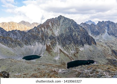 Hiking in High Tatras Mountains (Vysoke Tatry), Slovakia. On the way to Furkotsky Stit mount (2403m). Okruhle pleso lake (2105m) and Capie Pleso lake (2075m). Mount Strbsky Stit (2381m) on background