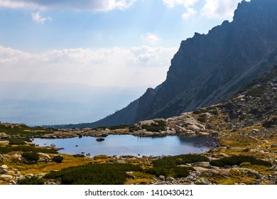Hiking in High Tatras Mountains (Vysoke Tatry), Slovakia. Lake over Skok waterfall (Slovak: Pleso nad Skokom). Lies on 1801m directly above the Mlynicka dolina threshold above the Skok Waterfall