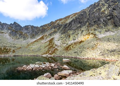 Hiking in High Tatras Mountains (Vysoke Tatry), Slovakia. On the way to Furkotsky Stit mount (2403m). Capie Pleso lake (2075m). Largest lake in the Mlynicka Valley in Tatras