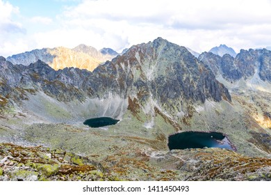Hiking in High Tatras Mountains (Vysoke Tatry), Slovakia. Okruhle pleso lake (2105m) and Capie Pleso lake (2075m). Mount Strbsky Stit (2381m) on background. View from Furkotsky Stit mount (2403m)