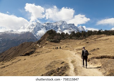 Hiking in Himalaya mountains.  Traveler with Backpack hiking in the Mountains. mountaineering sport lifestyle concept
