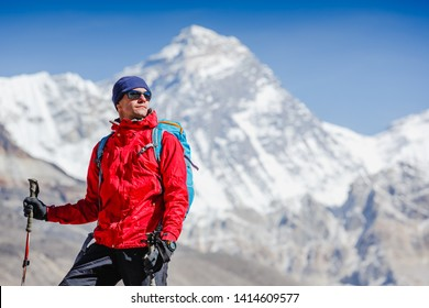Hiking in Himalaya mountains. Young man with backpack enjoying Everest view