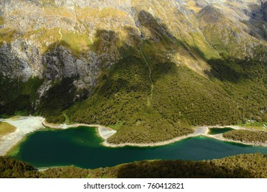 Hiking the incredible Routeburn Track Great Walk in New Zealand with amazing lake and mountain panorama views