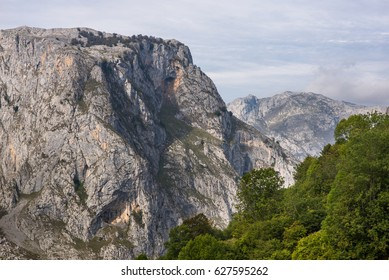 Hiking in the Los Picos de Europa up to the viewpoints, to see the mountain Naranjo de Bulnes and the summits of the neighborhood of the village Bulnes in Asturias Spain