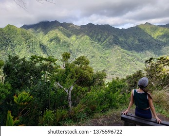 Hiking the Manoa Cliff Trail bench with view of the mountains in Honolulu, Oahu Island, Hawaii.