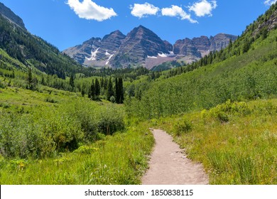 Hiking at Maroon Bells - Summer view of a hiking trail in Maroon Creek Valley at base of Maroon Bells. Aspen, Colorado, USA.