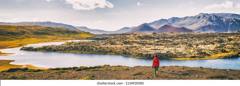 Hiking nature amazing landscape travel wanderlust woman hiker on holiday in Iceland. Panoramic banner hero view of icelandic lake.