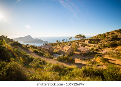 Hiking near La Trapa monastery with Sa Dragonera island in background, Serra de Tramuntana, Mallorca, Spain