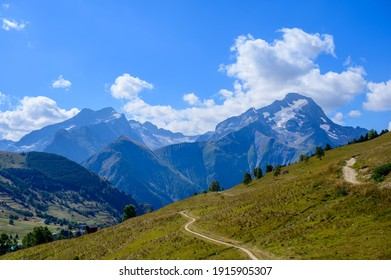 Hiking near ski station Les deux Alpes and view on Alpine mountains peaks in summer, Les Ecrins range, Isere, France - Shutterstock ID 1915905307