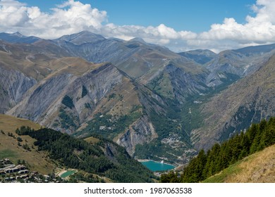 Hiking near ski station Les deux Alpes and view on Alpine mountains peaks in summer, Les Ecrins range, Isere, France - Shutterstock ID 1987063538