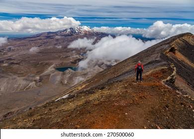 Hiking on the edge of Ngauruhoe volcano crater, Tongariro national park, North island, New Zealand
