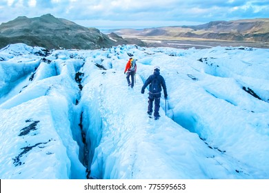 Hiking on the ice blue glacier in Iceland