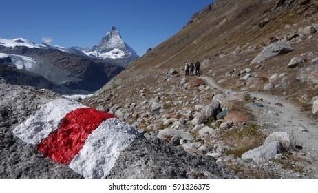 Hiking on hiking trail with Zermatt / Matterhorn in the background