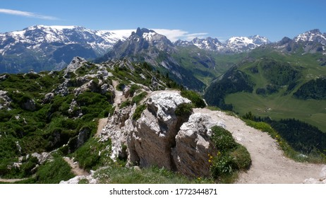 hiking path with magnificient panoramic view at the summit of dent du villard mountain range above courchevel ski resort in summer